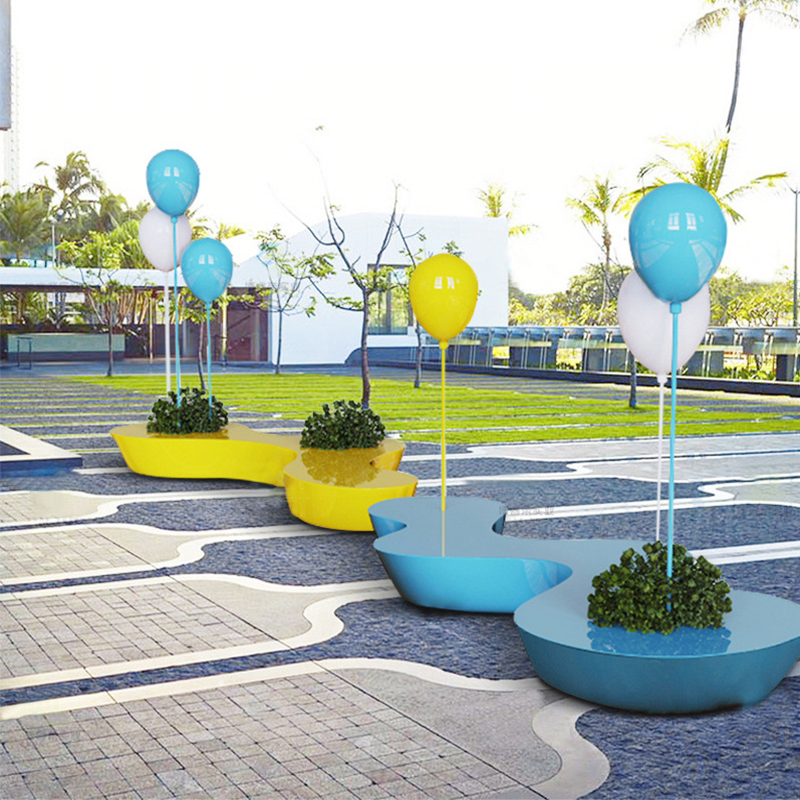 玻璃钢家具厂家,生产定制玻璃钢气球花盆坐凳!